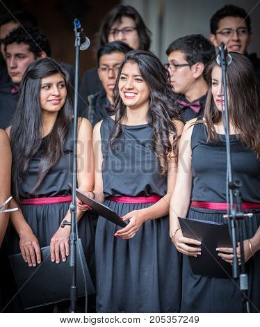 Young Woman Prepares For Solo Performance In Choir