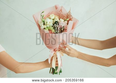 Young female with a bouquet of flowers delivery