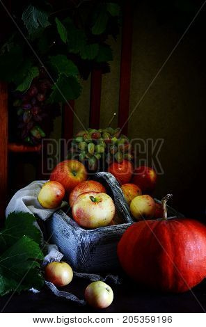 Wooden box with fragrant ripe Apples Grapes Pumpkin Fruit and Vegetables Basket Organic