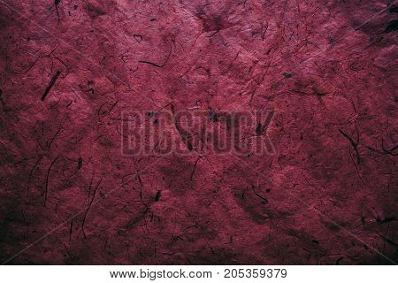 Abstract red texture and background for designers. Vintage paper background. Rough red texture of recycled paper. Closeup view of abstract red texture. Vintage red paper.