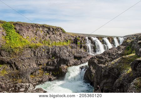 Kolugljufur waterfall in Iceland on a summer day