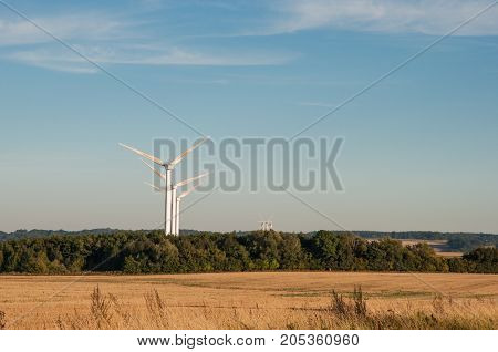 windmills in danish landscape on a sunny summer day