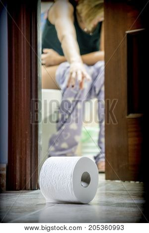 Woman sat in the bath loses the toilet paper roll in the soil