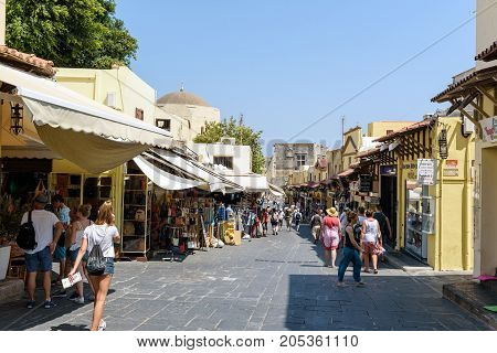 RHODES, GREECE - AUGUST 2017: People are walking on the street of Rhodes town, Rhodes island, Greece