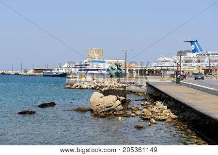 RHODES, GREECE - AUGUST 2017: Coastline of Rhodes town seaport on Rhodes island, Greece