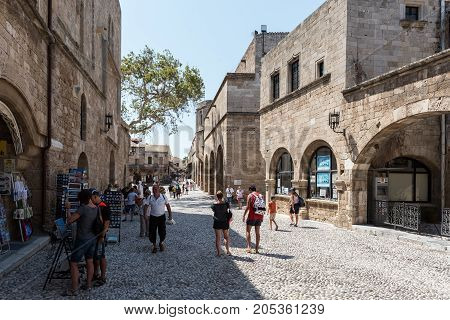 RHODES, GREECE - AUGUST 2017: Tourists are visiting streets of old Rhodes town on Rhodes island, Greece