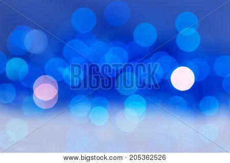 Abstract blue bokeh background. Lights blue defocus.