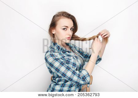 Beauty Portrait Of Young Adorable Fresh Looking Blonde Woman In Blue Plaid Shirt. Emotion And Facial