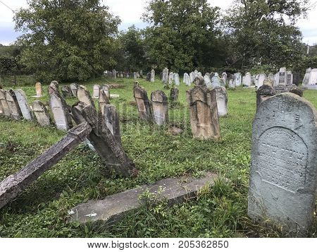 Teresva, Ukraine, September 18, 2017; An Old Jewish Cemetery. Shattered Gravestones Stand Among The