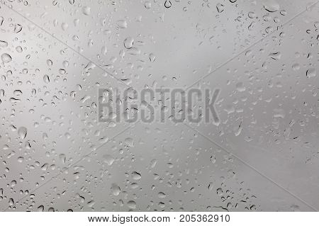 weather, background, uniqueness concept. close up of the window, there are lots of rain drops on it, they are like snowflakes very special, each has its own size and form
