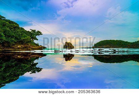 Sunset Reflections at Ngliyep Beach, Malang, Indonesia