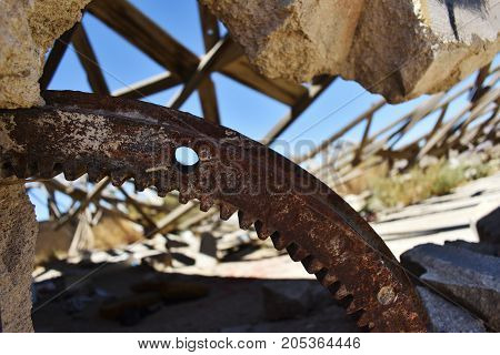 Close up of ruined stone building in the desert. Rust and decay.