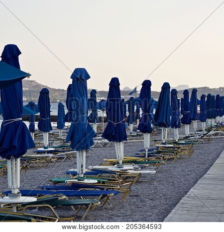 empty beach with sunbeds and sunshades - tourism