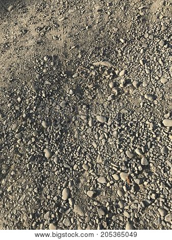 Dusty And Dirty Surface Of A Dirt Road. A Lot Of Gravel And Pebbles. View From Above.