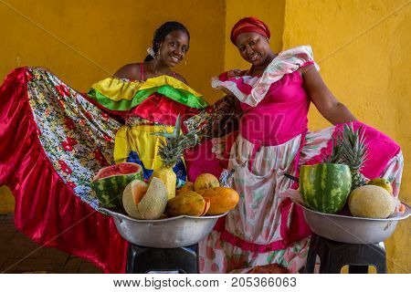 Women Show Off Their Elaborate Dresses