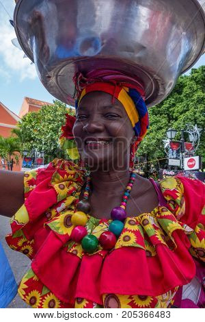 Women Show Off Their Elaborate Dresses And Headware