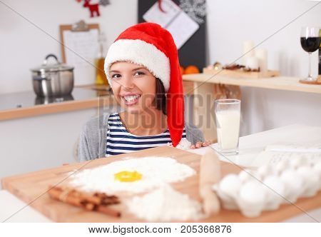 Woman making christmas cookies in the kitchen.