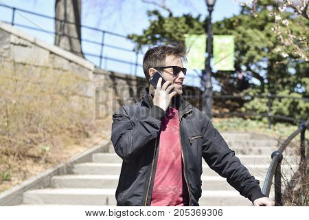 Young Man Talking On His Cell Phone