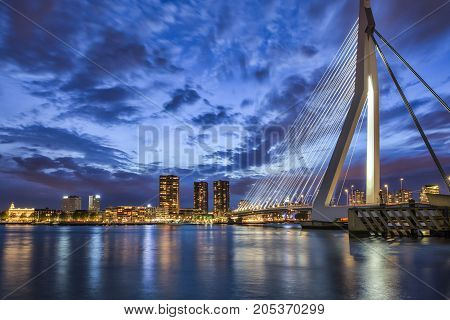 Travel Ideas. Picturesque View of Erasmusbrug (Erasmus Bridge) in Rotterdam at Twilight. Cityscape Image of Rotterdam in The Netherlands During Blue Hour. Horizontal Image Composition