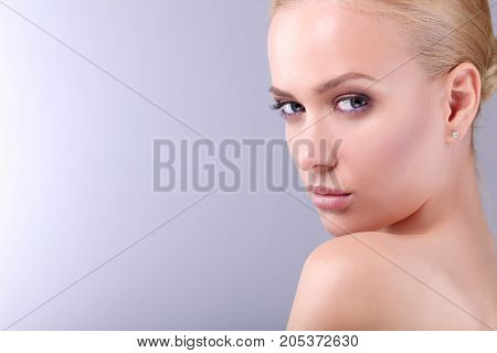 Beauty. Portrait of a young woman on white background.
