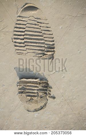 Footstep Pattern On A Concrete Background