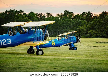 Two Stearman biplanes preparing for takeoff at the 2016 Flying Circus Airshow in Bealeton Virginia
