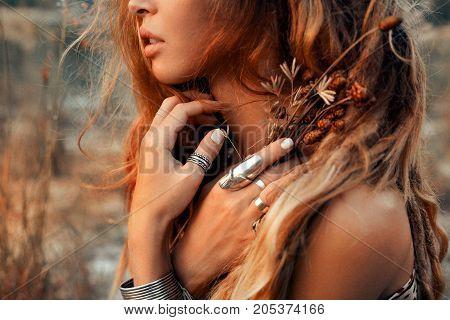 close up of beautiful young woman at sunset