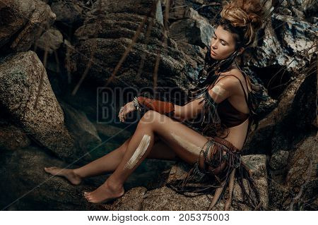 beautiful young wild amazon woman in forest