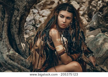 beautiful wild amazon woman with dreadlocks in forest