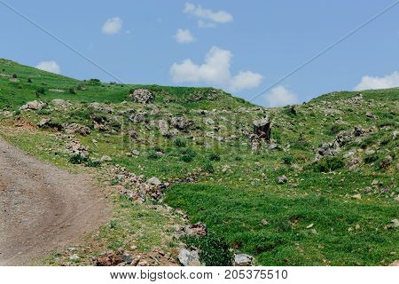 Road in the mountains of Armenia. horizontal shot in the afternoon