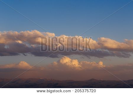 Clouds over the mountains of Armenia. horizontal shot in the evening