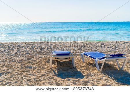 Beautiful tropical beach and Caribbean sea with sunbeds