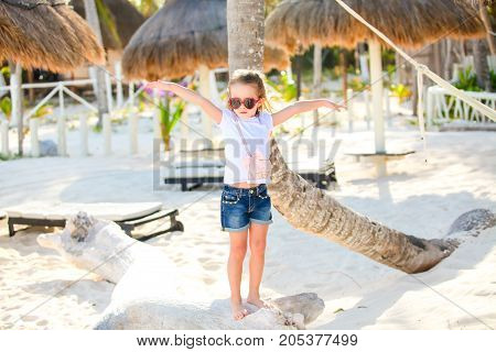 Adorable happy smiling little girl on beach