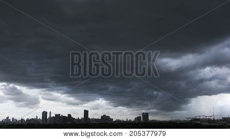 Thunderstorm with rain cloud over the city in BangkokThailand.