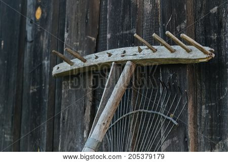 Wooden and metal rake. Object photo. horizontal shot