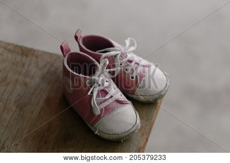 Old baby sneakers closeup photo. horizontal day shot