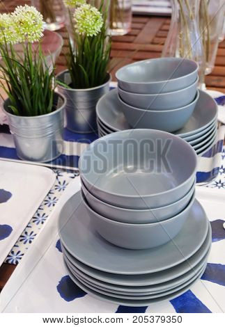 Kitchen Utensil Set of Porcelain Dishes Bowls and Plates Preparing for Serve Hot and Cold Food.
