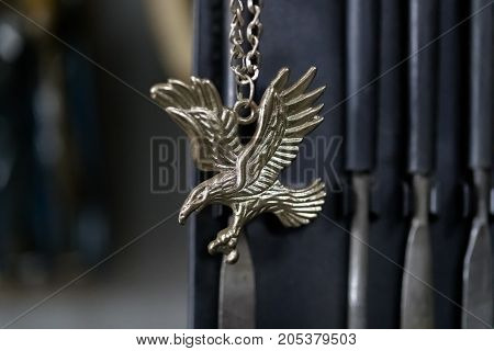 eagle medallion on chain. horizontal shot close-up