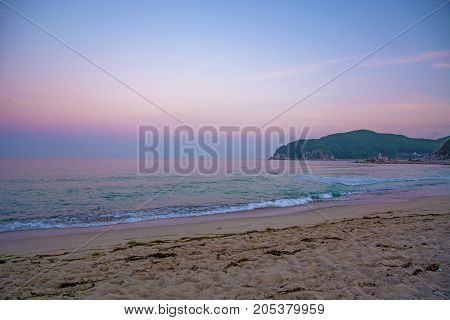 beautiful pink sunset on the beach. the Sun sit down and leave the pink sky. the calm sea, calm
