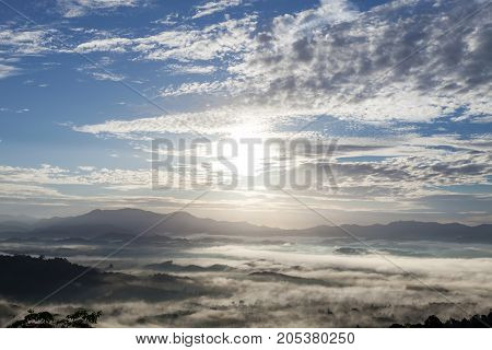 beautiful sunlight in the morning sunrise above flowing fog waves on mountain tropical rainforest in phang nga thailand