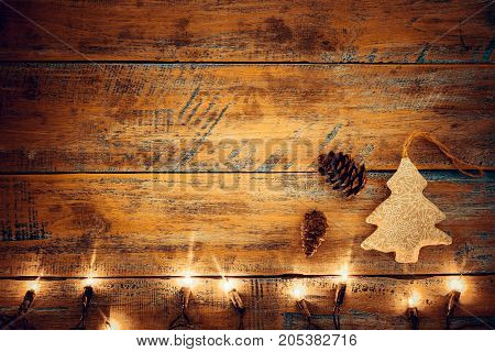 Christmas lights bulb with decoration on wood table. Merry christmas (xmas) background. topview border design - rustic and vintage styles