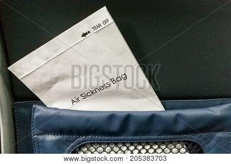 Air Sickness Bag Tucked Behind Airplane Seat Pocket