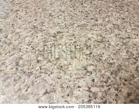 a white and black marble surface with speckles