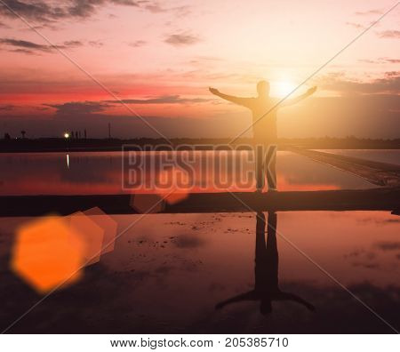 Silhouette man with hands rise up on beautiful view. Christian praise on hill thanksgiving day background. Now one man standing on peak open arms enjoying nature the sun concept world wisdom fun hope