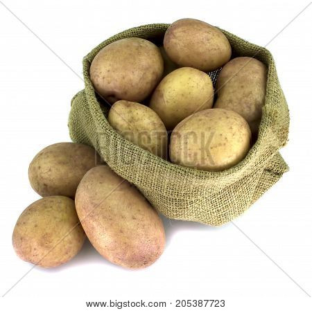 Raw potatoes in burlap bag isolated on white background