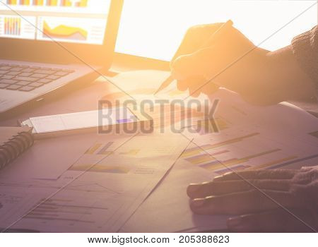 Hand man doing finances on desk about cost at home office / soft focus picture / Vintage concept