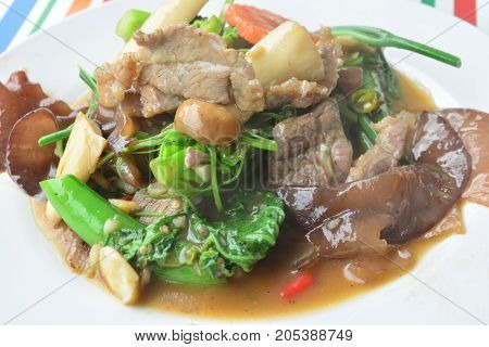 The Mongolian-style stir-fried vegetables with beef, note select focus with shallow depth of field