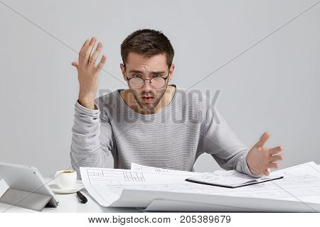 Puzzled And Frustrated Young Architect In Casual Sweatshirt And Trendy Glasses Feeling Indignant, Lo