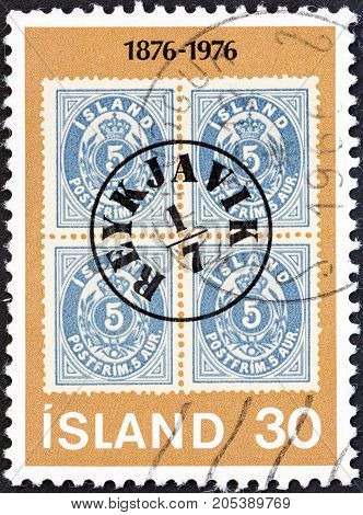 ICELAND - CIRCA 1976: A stamp printed in Iceland issued for the centenary of Icelandic Aurar Currency Stamps shows Iceland 5a, stamp with Reykjavik Postmark, 1876, circa 1976.