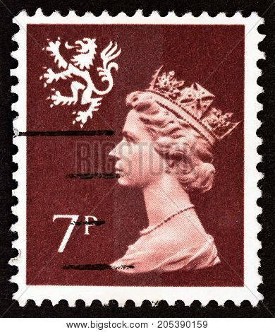 UNITED KINGDOM - CIRCA 1978: A stamp printed in United Kingdom shows Queen Elizabeth II and Royal Arms of Scotland, circa 1978.